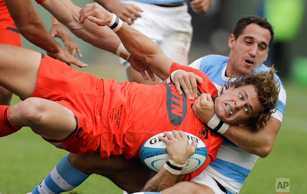 South Africa's Andries Coetzee is tackled by Argentina's Los Pumas Joaquin Tuculet during a Rugby Championship match in Salta, Argentina, Saturday, Aug. 26, 2017.(AP Photo/Natacha Pisarenko)