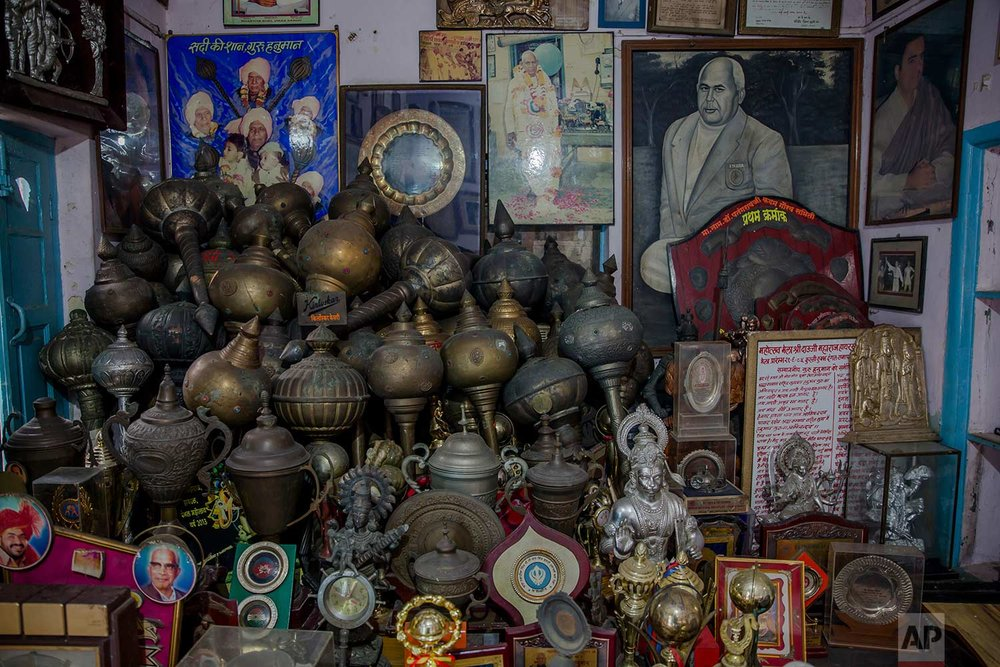In this Nov. 20, 2017 photo, photographs and trophies belonging to Indian Kushti wrestlers are seen inside the office of Guru Hunuman Akhada, one of India's oldest akhadas at Sabzi Mandi, in New Delhi, India. (AP Photo/Dar Yasin)