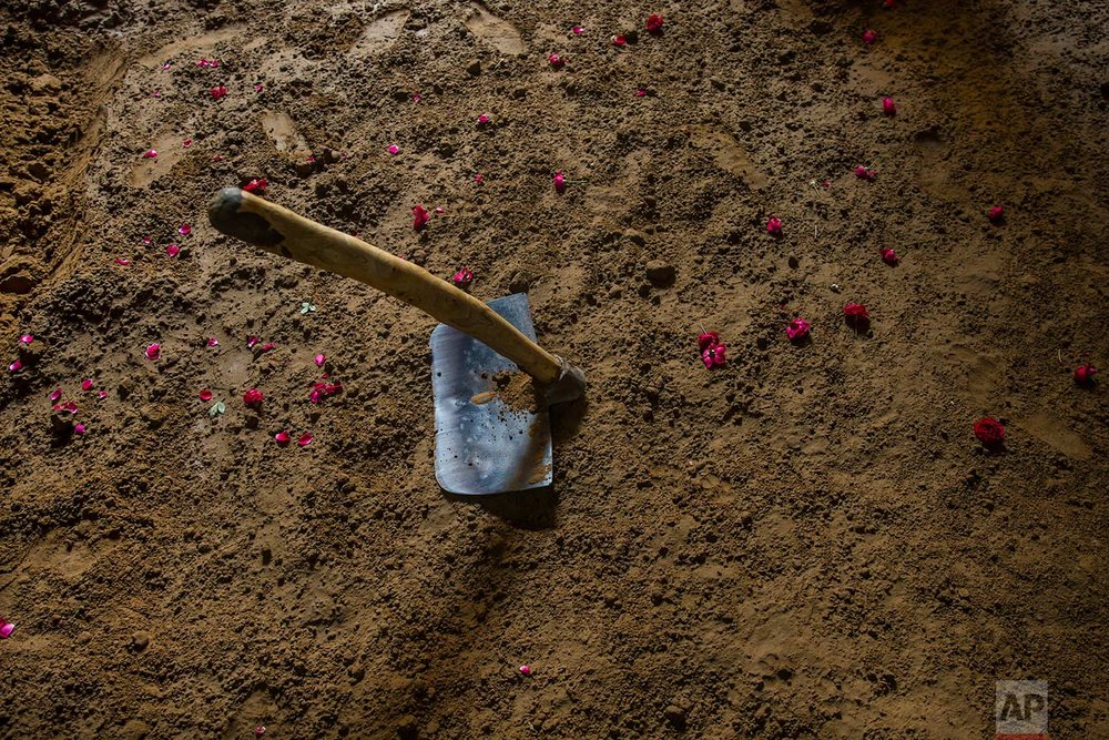 In this Nov. 20, 2017 photo, a spade and flowers from the weekly prayers are seen inside the ring at an akhada, a kind of wrestling hostel at Sabzi Mandi, in New Delhi, India. (AP Photo/Dar Yasin)