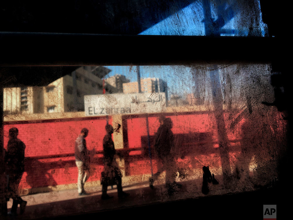 In this March 13, 2017 photo, people are seen from the window of a metro car, at El Zahraa metro station in Cairo, Egypt. Cairo's subway is perhaps the cheapest in the world, 11 cents to ride as far as you want across the overcrowded, traffic-choked Egyptian capital -- but even that feels like a burden to many Egyptians at a time of tough economic reforms. (AP Photo/Nariman El-Mofty)