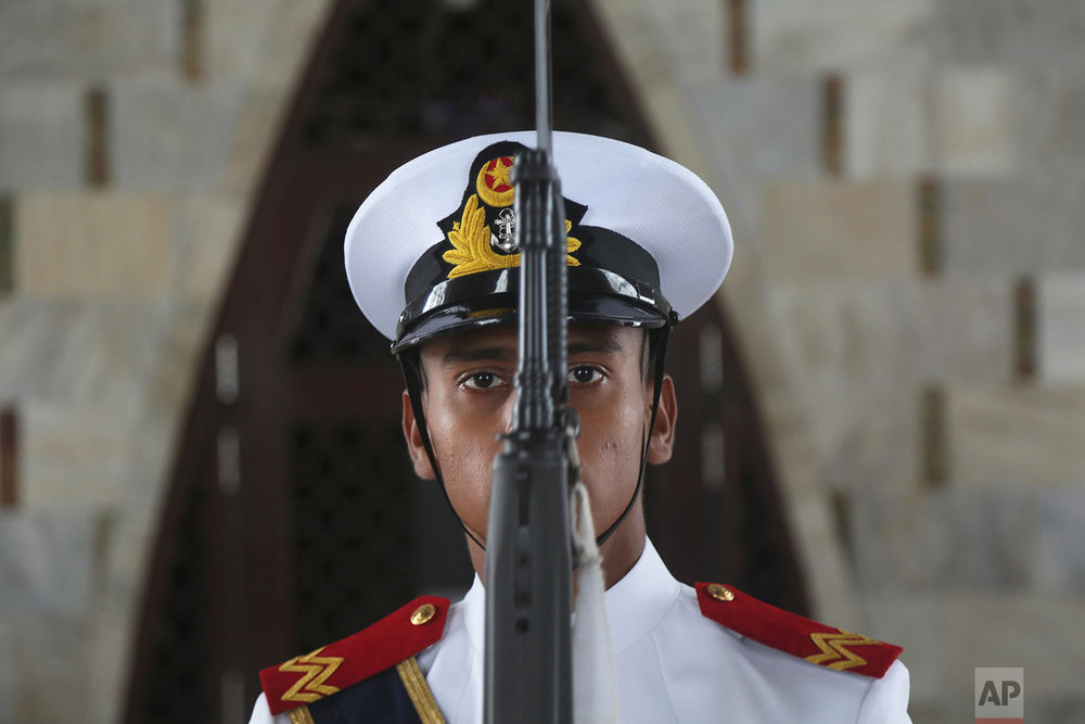 A Pakistani Sailor stands guard at the mausoleum of Muhammad Ali Jinnah, founder of Pakistan during a parade to celebrate the 70th Independence Day in Karachi, Pakistan, Monday, Aug. 14, 2017. Pakistanis commemorated its independence from British colonial rule in 1947. (AP Photo/Shakil Adil)