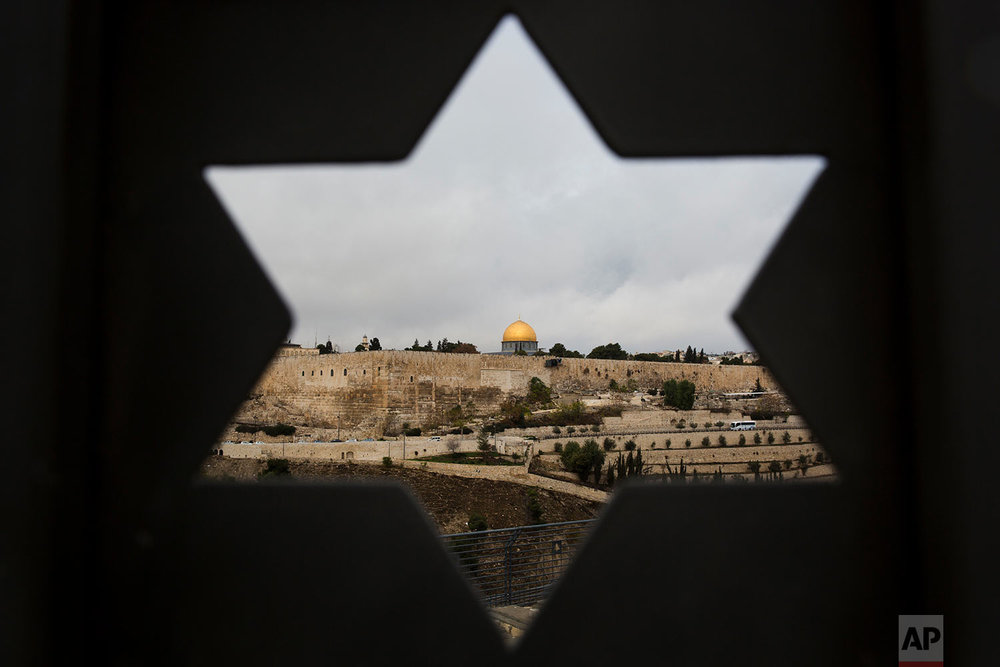 Jerusalem Old City is seen trough a door with the shape of star of David, in Jerusalem, Wednesday, Dec. 6, 2017. U.S. officials say President Donald Trump will recognize Jerusalem as Israel's capital Wednesday, Dec. 6, and instruct the State Department to begin the multi-year process of moving the American embassy from Tel Aviv to the holy city. His decision could have deep repercussions across the region. (AP Photo/Oded Balilty)
