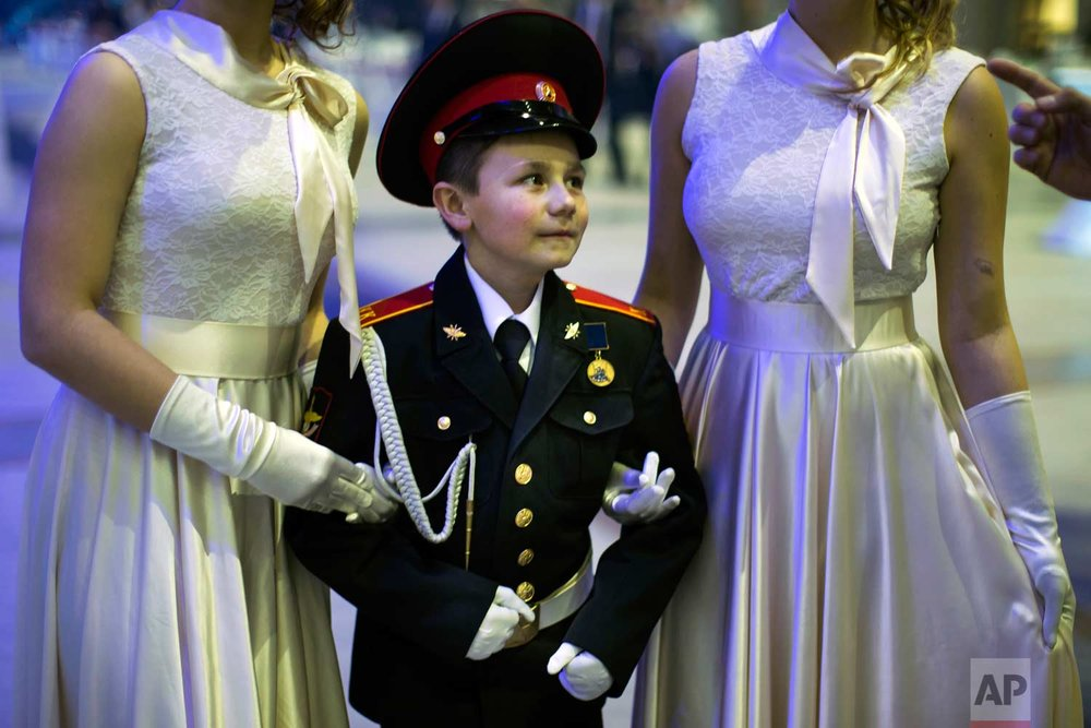 Military school students wait to dance during their annual ball in Moscow, Russia, Tuesday, Dec. 12, 2017. (AP Photo/Alexander Zemlianichenko)