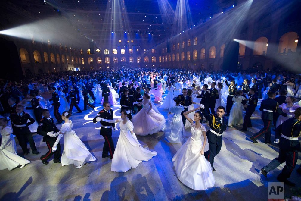 Military school students dance during their annual ball in Moscow, Russia, Tuesday, Dec. 12, 2017. (AP Photo/Alexander Zemlianichenko)