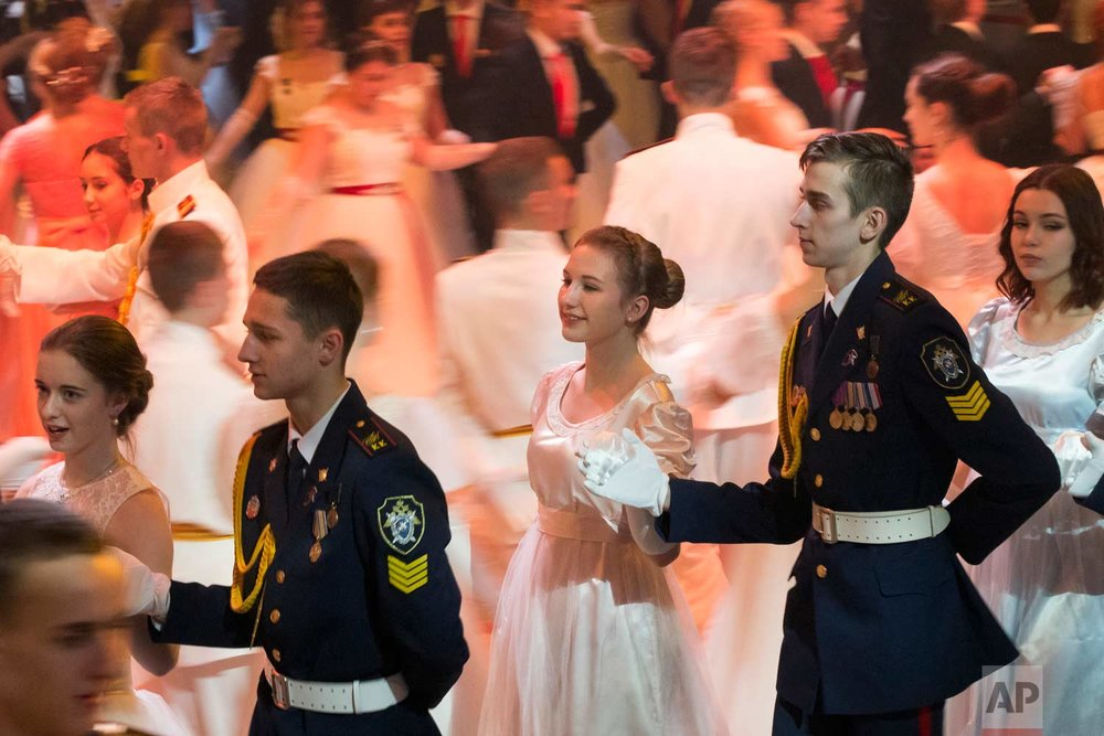 Participants of a ball for students of military schools perform during an annual ball in Moscow, Russia, Tuesday, Dec. 12, 2017. (AP Photo/Alexander Zemlianichenko)