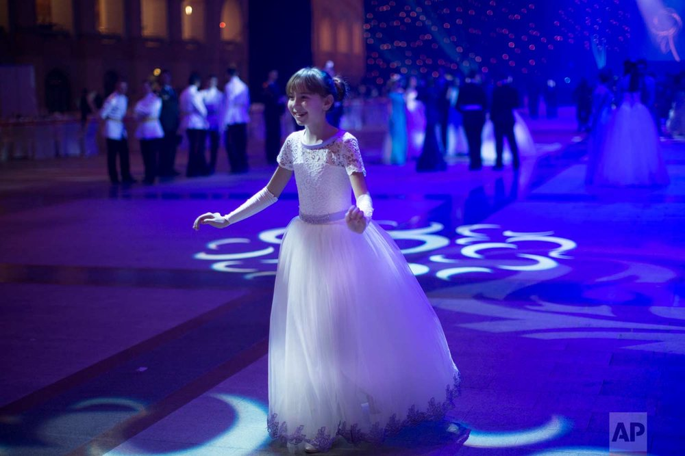 A military school student rehearses before the annual ball in Moscow, Russia, Tuesday, Dec. 12, 2017. (AP Photo/Alexander Zemlianichenko)