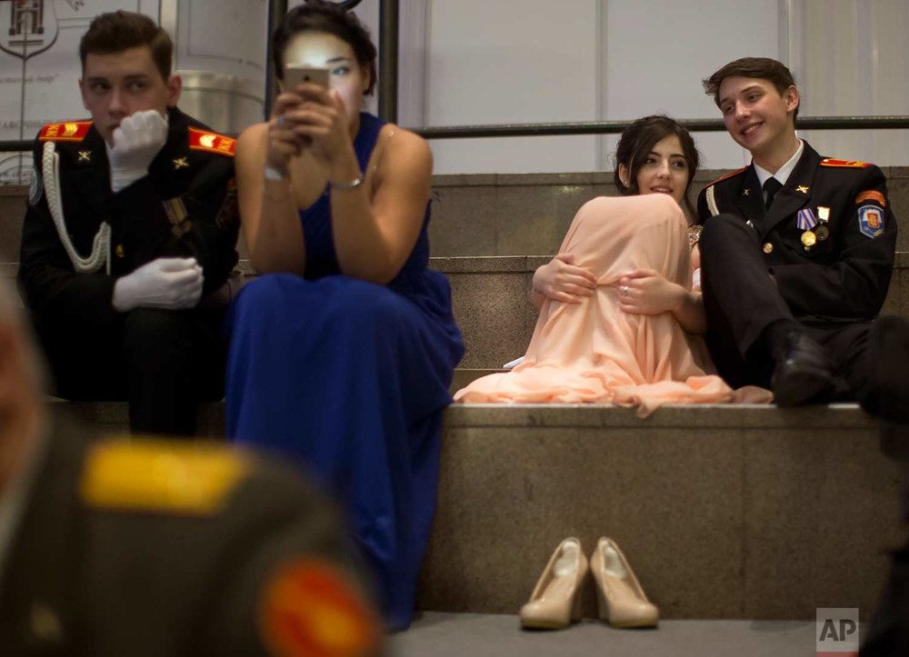 Military school students rest during their annual ball in Moscow, Russia, Tuesday, Dec. 12, 2017. (AP Photo/Alexander Zemlianichenko)