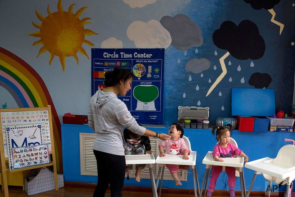 Children attend classes at a foster home of the New Hope Foundation on the outskirts of Beijing, China on Wednesday, Oct. 11, 2017. (AP Photo/Ng Han Guan)