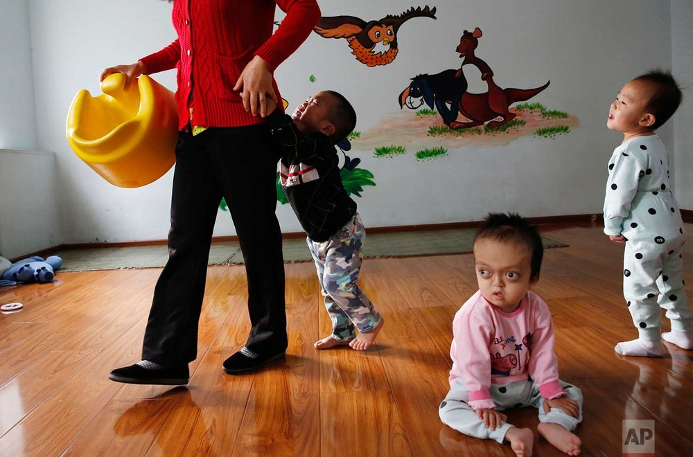 Children rest and play at a foster home of the New Hope Foundation on the outskirts of Beijing, China, on Wednesday, Oct. 11, 2017. (AP Photo/Ng Han Guan)