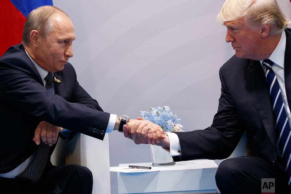 In this Friday, July 7, 2017 photo, President Donald Trump shakes hands with Russian President Vladimir Putin at the G20 Summit in Hamburg. (AP Photo/Evan Vucci)