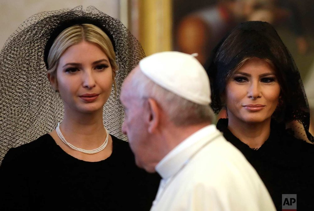 In this Wednesday, May 24, 2017 photo, Pope Francis walks past Ivanka Trump, left, and First Lady Melania Trump on the occasion of the private audience with President Donald Trump, at the Vatican. (AP Photo/Alessandra Tarantino)