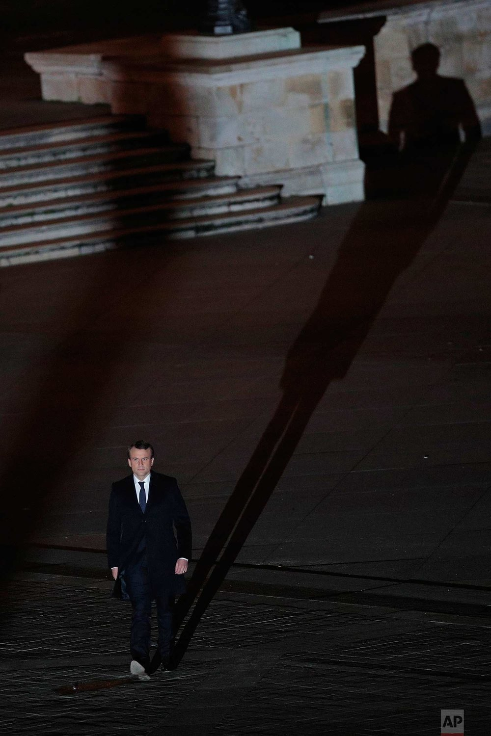 In this Sunday May 7, 2017 photo, incoming French President Emmanuel Macron walks towards the stage to address his supporters at the Louvre Palace in Paris. Polling agencies have projected that centrist Macron will be France's next president, putting a 39-year-old political novice at the helm of one of the world's biggest economies and slowing a global populist wave. (AP Photo/Christophe Ena)