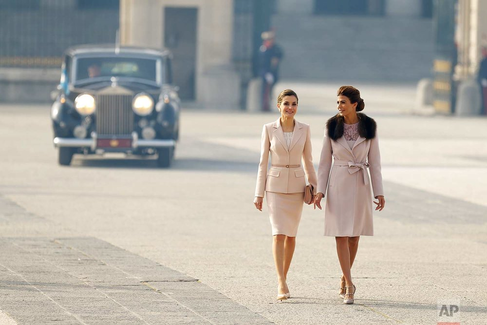 In this Wednesday, Feb. 22, 2017 photo, Spain's Queen Letizia, left, talks to Juliana Awada, the wife of the Argentina's President Mauricio Macri, during a welcome ceremony at the Royal Palace in Madrid. Macri and his wife Awada are on the first of a four day official visit to Spain. (AP Photo/Francisco Seco)