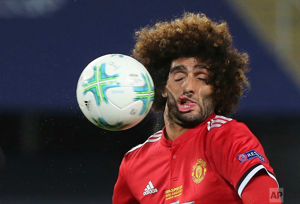 Manchester United's Marouane Fellaini heads the ball during the UEFA Super Cup final soccer match between Real Madrid and Manchester United at Philip II Arena in Skopje, on Aug. 8, 2017. (AP Photo/Boris Grdanoski)