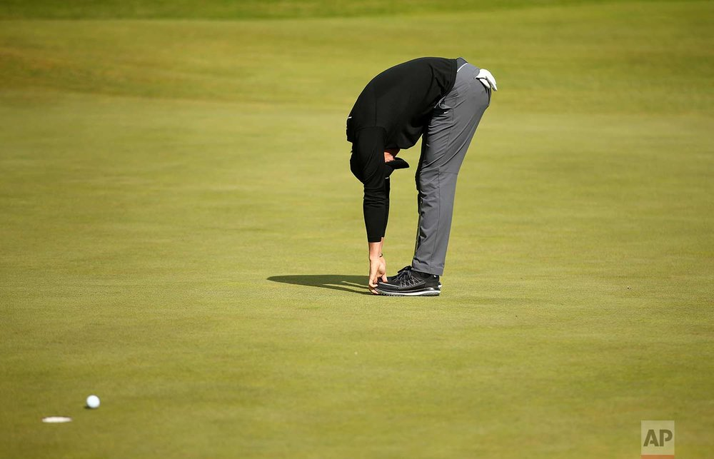 In this Saturday July 22, 2017 photo, Northern Ireland's Rory McIlroy reacts to a missed putt on the 4th green during the third round of the British Open Golf Championship, at Royal Birkdale, Southport, England. (AP Photo/Dave Thompson)