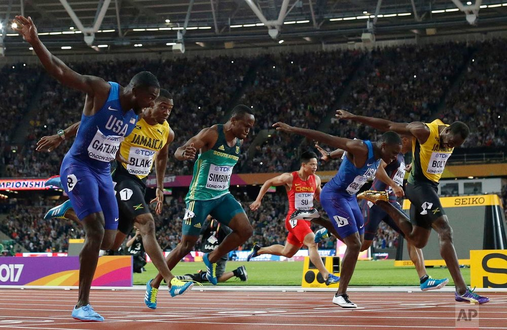 In this Saturday, Aug. 5, 2017 photo, United States' Justin Gatlin, left, crosses the line to win gold ahead of silver medal winner United States' Christian Coleman, second right, and bronze medal winner Jamaica's Usain Bolt, right, in the men's 100m final during the World Athletics Championships in London. (AP Photo/Matt Dunham)