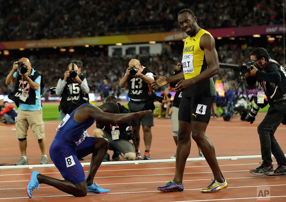 In this Saturday, Aug. 5, 2017 photo, United States' Justin Gatlin bows to Jamaica's Usain Bolt after winning the Men's 100 meters final during the World Athletics Championships in London. (AP Photo/Tim Ireland)