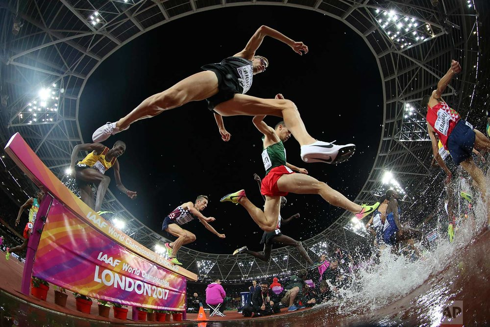 In this Tuesday, Aug. 8, 2017 photo, athletes compete in the men's 3000-meter steeplechase final during the World Athletics Championships in London. (AP Photo/Matthias Schrader)