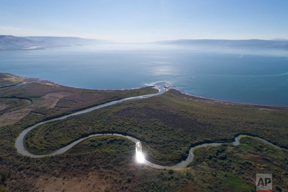 In this Friday, Dec. 8, 2017 photo, an aerial view shows the Jordan River estuary of the Sea of Galilee near the community settlement of Karkom, northern Israel. (AP Photo/Oded Balilty)