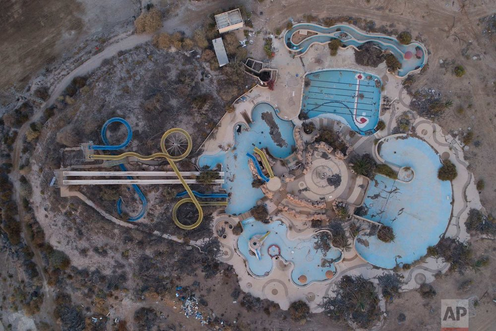 In this Nov. 28, 2017 photo, an aerial view of the abandoned Kalya water park on the Dead Sea shore. (AP Photo/Oded Balilty)
