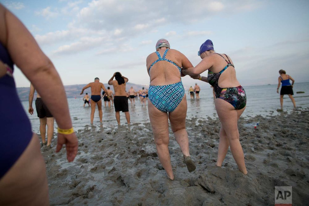 In this Saturday, Sept. 16, 2017 photo, swimmers participate in the annual Sea of Galilee swim, the oldest and most popular swimming event, near Tiberias, northern Israel.(AP Photo/Oded Balilty)