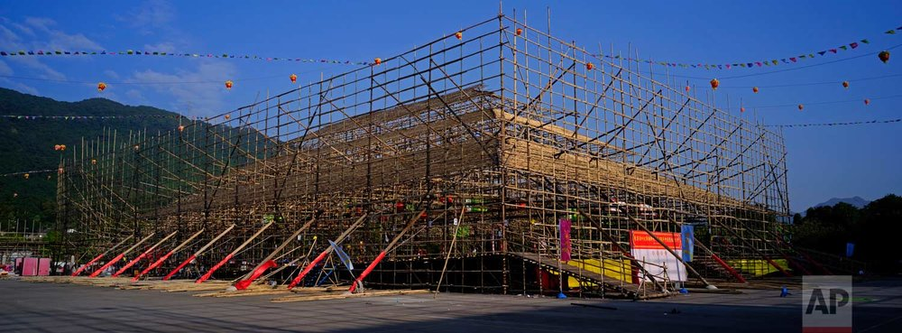 In this Dec. 19, 2017 photo, a huge bamboo theater is seen during its demolition after the Tai Ping Ching Jiu festival at Lam Tsuen village in Hong Kong. (AP Photo/Vincent Yu)