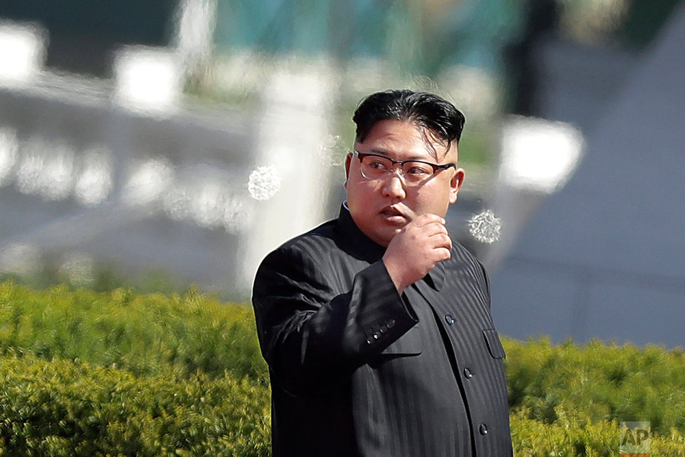North Korean leader Kim Jong Un arrives for the official opening of the Ryomyong residential area, Thursday, April 13, 2017, in Pyongyang, North Korea. Japan's Prime Minister Shinzo Abe, speaking Thursday at a parliamentary panel on national security and diplomacy, warned that North Korea may be capable of firing a missile loaded with sarin nerve gas toward Japan. (AP Photo/Wong Maye-E)