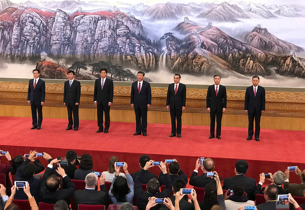 New members of the Politburo Standing Committee, from left, Han Zheng, Wang Huning, Li Zhanshu, Xi Jinping, Li Keqiang, Wang Yang, Zhao Leji stand together at Beijing's Great Hall of the People Wednesday, Oct 25, 2017. The seven-member Standing Committee, the inner circle of Chinese political power, was paraded in front of assembled media on the first day following the end of the 19th Communist Party Congress. (AP Photo/Ng Han Guan)