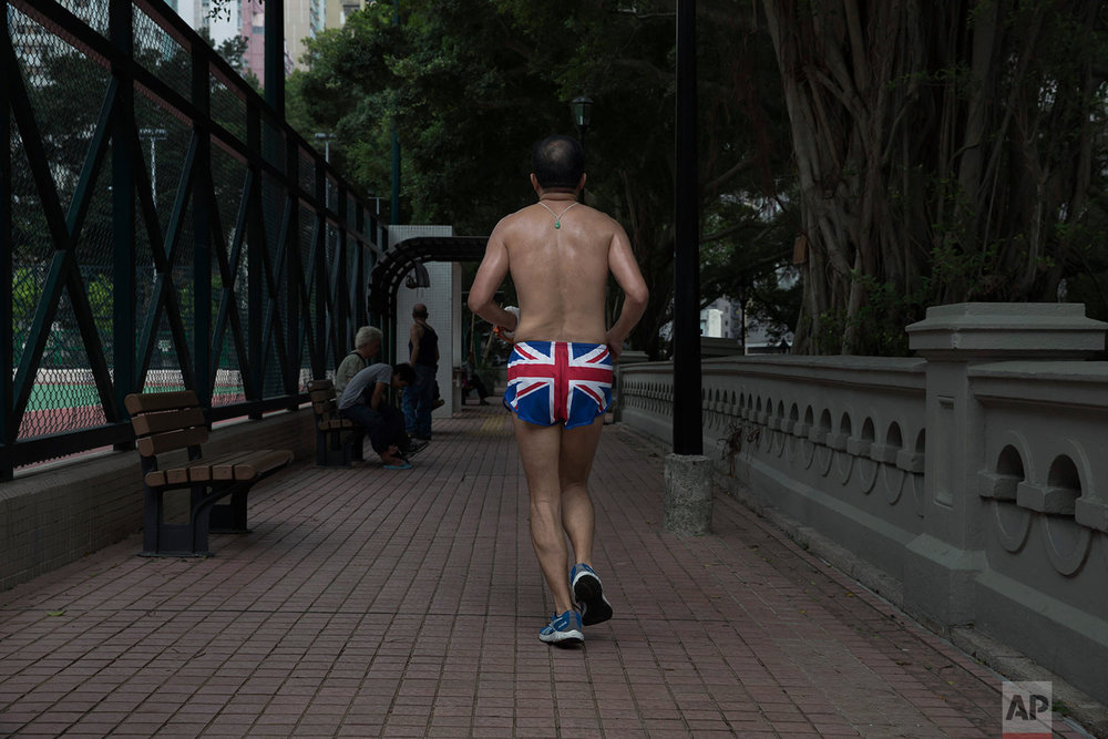 A man wearing the British flag shorts jogs at King George V Memorial Park in Hong Kong on Friday, June 2, 2017. Two decades after Hong Kong was handed to China, many residents continue to live their lives as before, holding onto old habits and routines as well as beliefs inspired by the former British colonial rulers, such as democracy, freedom of speech and justice. (AP Photo/Kin Cheung)
