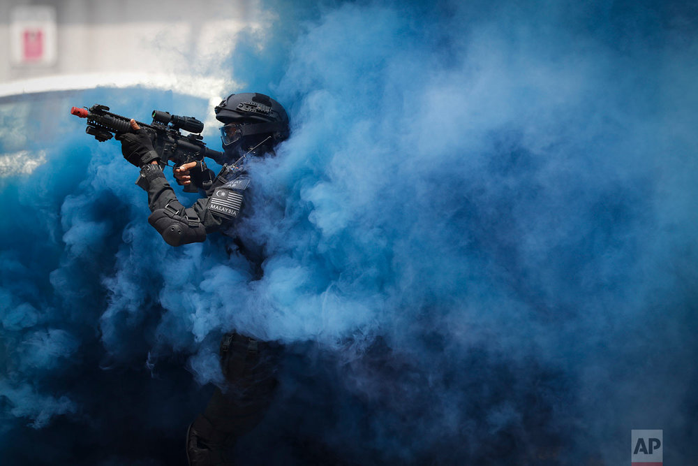 A member of the Royal Malaysian Police Special Tactical Unit takes part in a drill to prepare for the upcoming Southeast Asian Games at KL Sentral in Kuala Lumpur, Malaysia, Thursday, July 20, 2017. Kuala Lumpur will be the host city of the 29th SEA Games and the 9th ASEAN Para Games on Aug. 19-30. (AP Photo/Vincent Thian)
