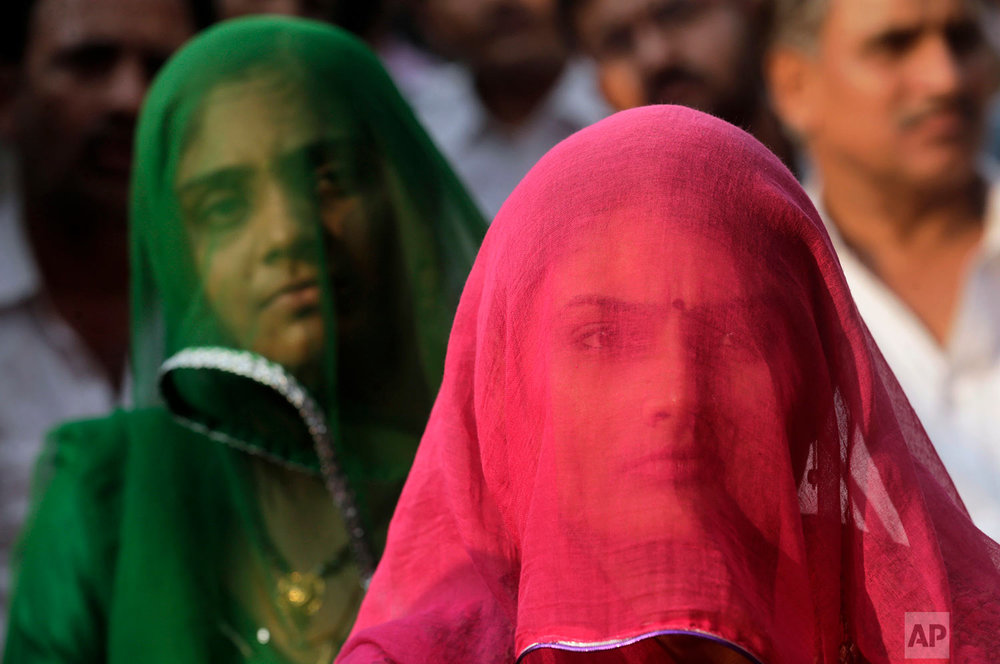 "In this Nov, 20, 2017, photo, veiled members of India's Rajput community listen to a speech by their leader as they gather to protest against the release of the Bollywood film ""Padmavati"" in Mumbai, India. The film has been in trouble since the beginning of the year, with fringe groups in the western state of Rajasthan attacking the film's set, threatening to burn down theaters that show it and even physically attacking the director in January. A member of India's Hindu nationalist ruling party has offered a 100 million rupee ($1.5 million) reward to anyone who beheads the lead actress and the director of the yet-to-be released film over its alleged handling of the relationship between a Hindu queen and a Muslim ruler. (AP Photo/Rafiq Maqbool)"