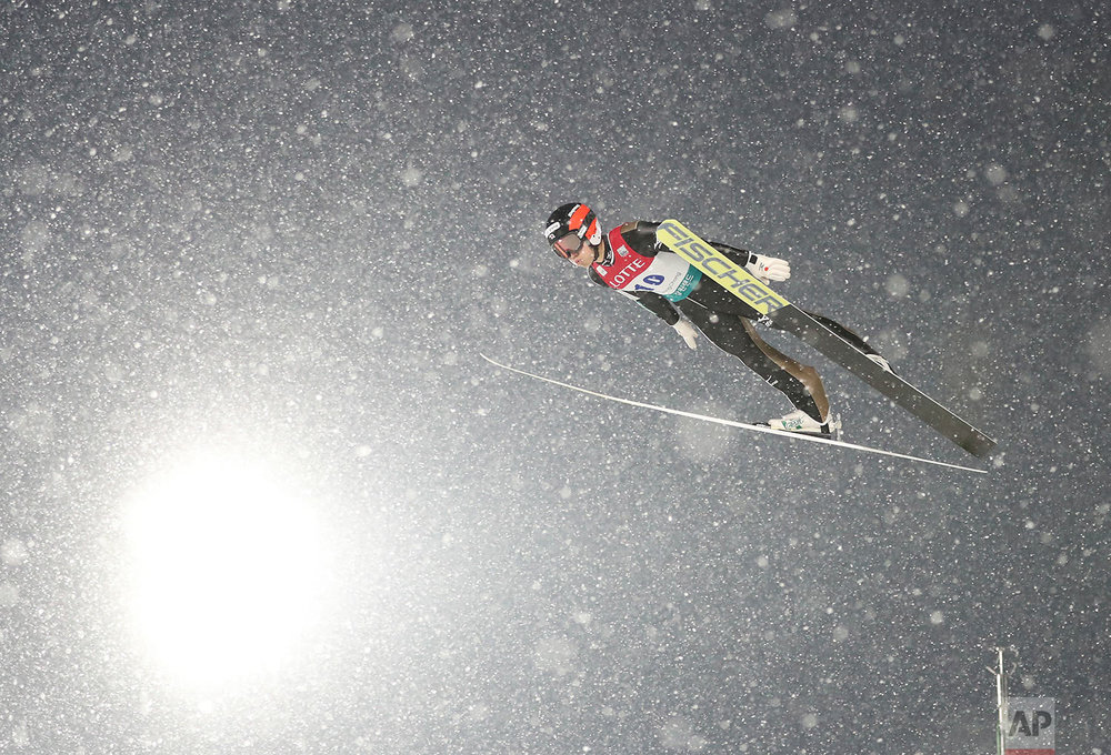 Japan's Aguri Shimizu soars through the air during the Individual Gundersen LH / 10 km event of the FIS Nordic Combined World Cup competition in Pyeongchang, South Korea, Sunday, Feb. 5, 2017. The World Cup competition is also a test event for the PyeongChang 2018 Winter Olympics. (AP Photo/Lee Jin-man)