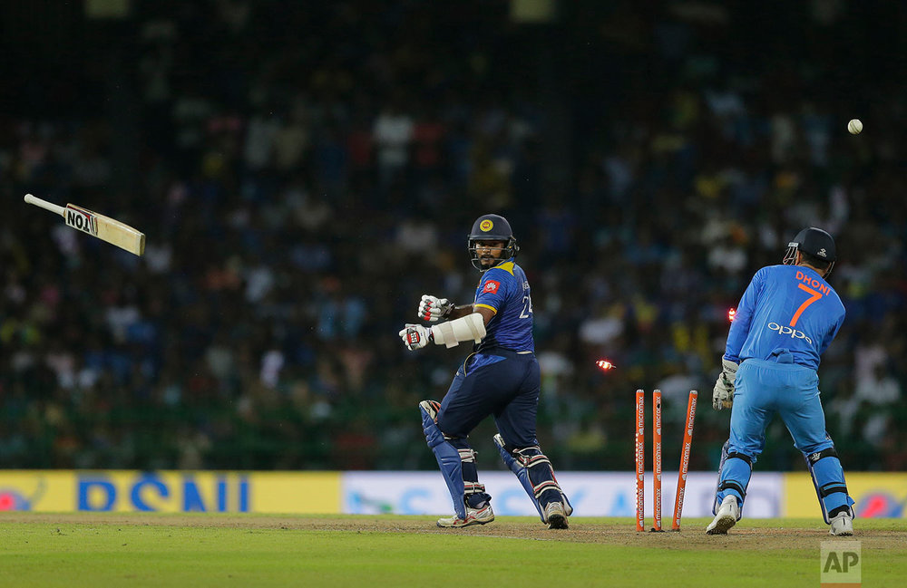 Sri Lanka's Dilshan Munaweera looses his bat as he is bowled by India's Kuldeep Yadav during their Twenty20 cricket match in Colombo, Sri Lanka, Wednesday, Sept. 6, 2017. (AP Photo/Eranga Jayawardena)