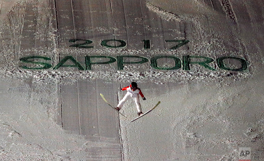 Japan's Naoki Nakamura soars through the air in his second round jump at the ski jumping men's large hill individual at the Asian Winter Games in Sapporo, northern Japan, Friday, Feb. 24, 2017.(AP Photo/Shuji Kajiyama)