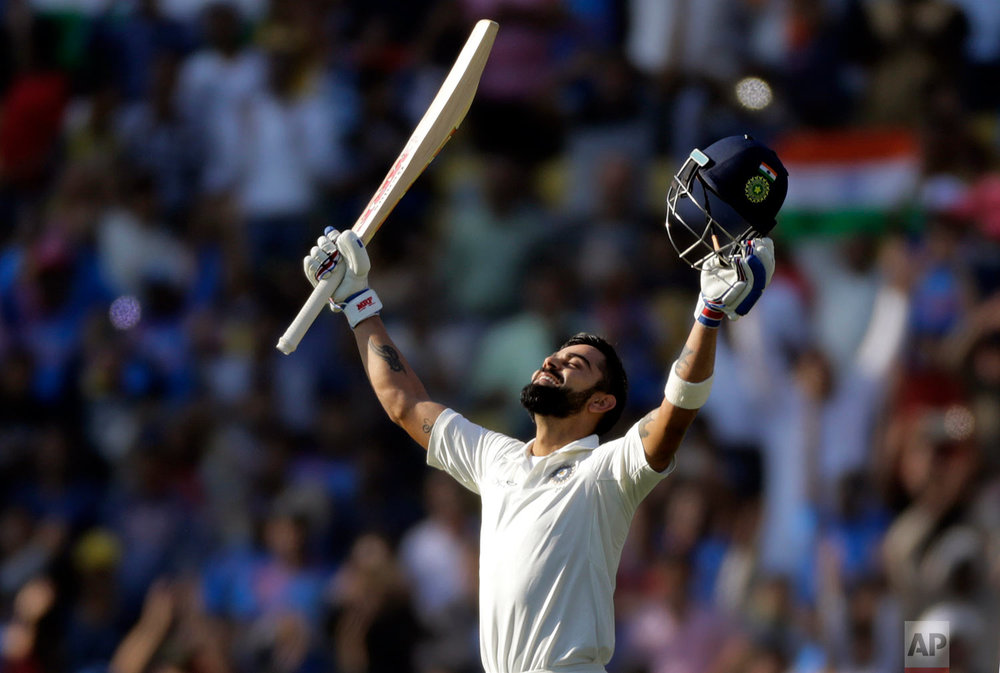 In this Nov. 26, 2017, photo, India's captain Virat Kohli looks skywards as he celebrates scoring double century during the third day of their second test cricket match against Sri Lanka in Nagpur, India. (AP Photo/Rajanish Kakade)