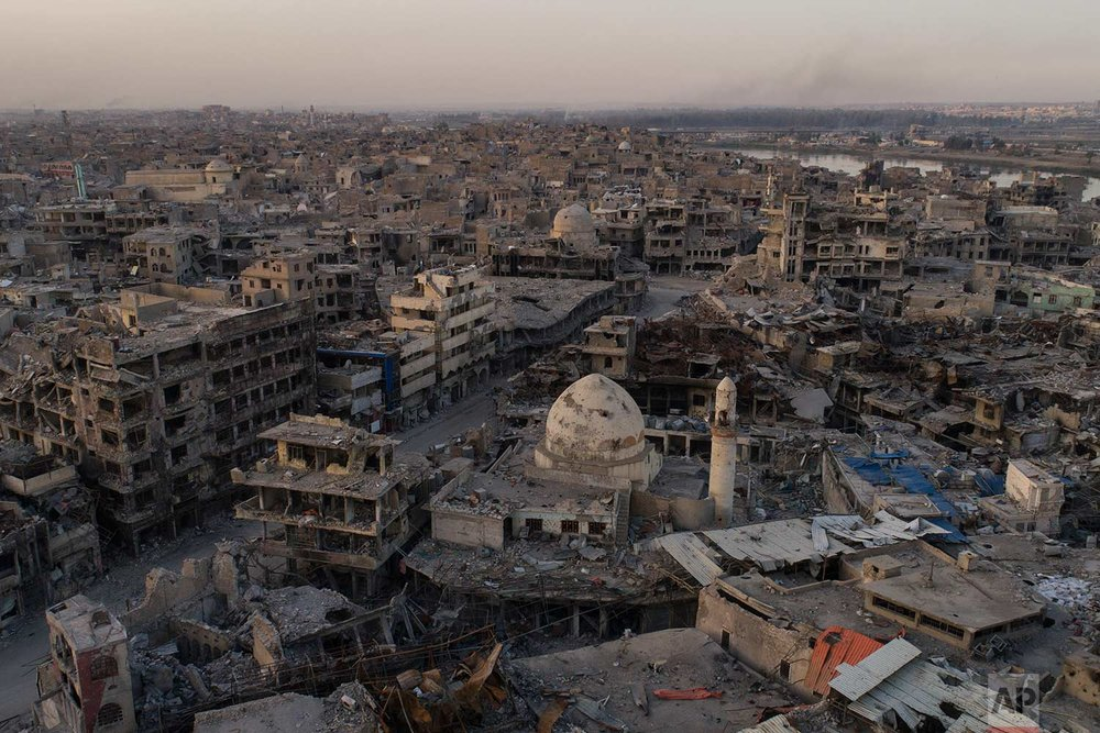 In this Nov. 15, 2017 photo, aerial view of destroyed building and shops in the Old City of Mosul, Iraq. (AP Photo/Felipe Dana)