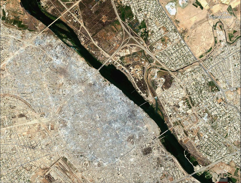 This satellite image released by DigitalGlobe shows the Old City of Mosul, Iraq on July 8, 2017 after a punishing nine month battle to oust Islamic State militants. (DigitalGlobe via AP)
