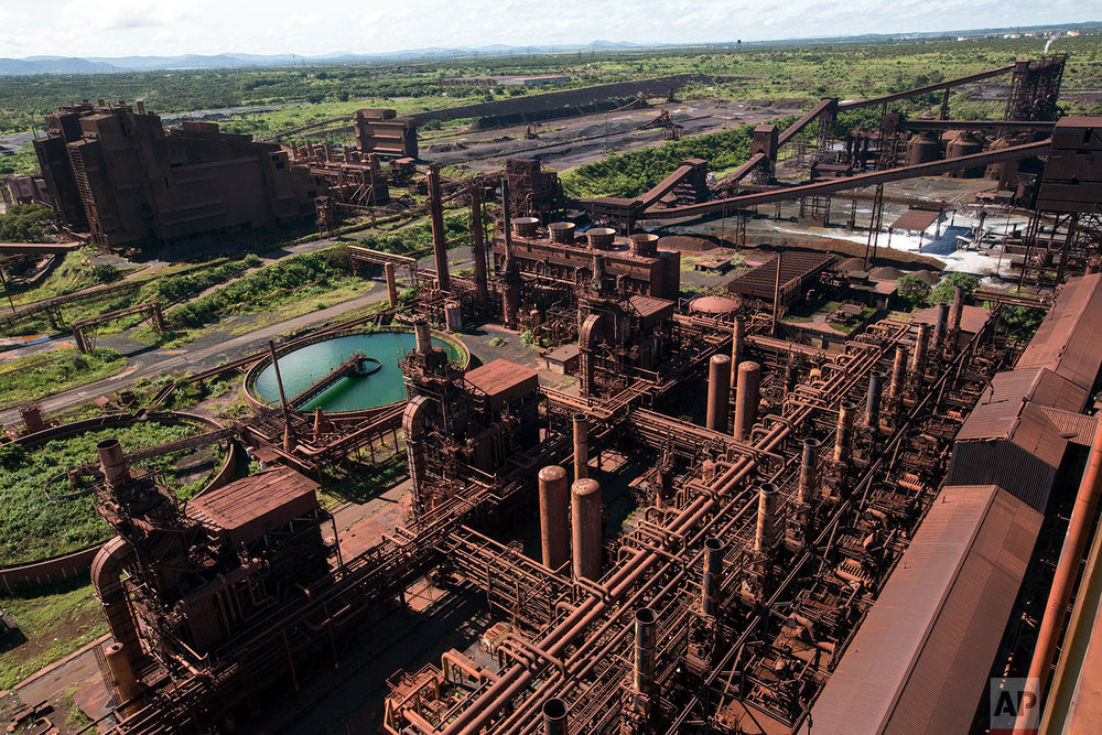 In this Nov. 7, 2017 photo, a Sidor steel plant that was never operational stands rusting away, in Ciudad Guayana, Bolivar state, Venezuela. Production this year at the state-run Sidor, Venezuela's largest steelmaker, is expected to reach barely 20 percent of peak production. (AP Photo/Rodrigo Abd)