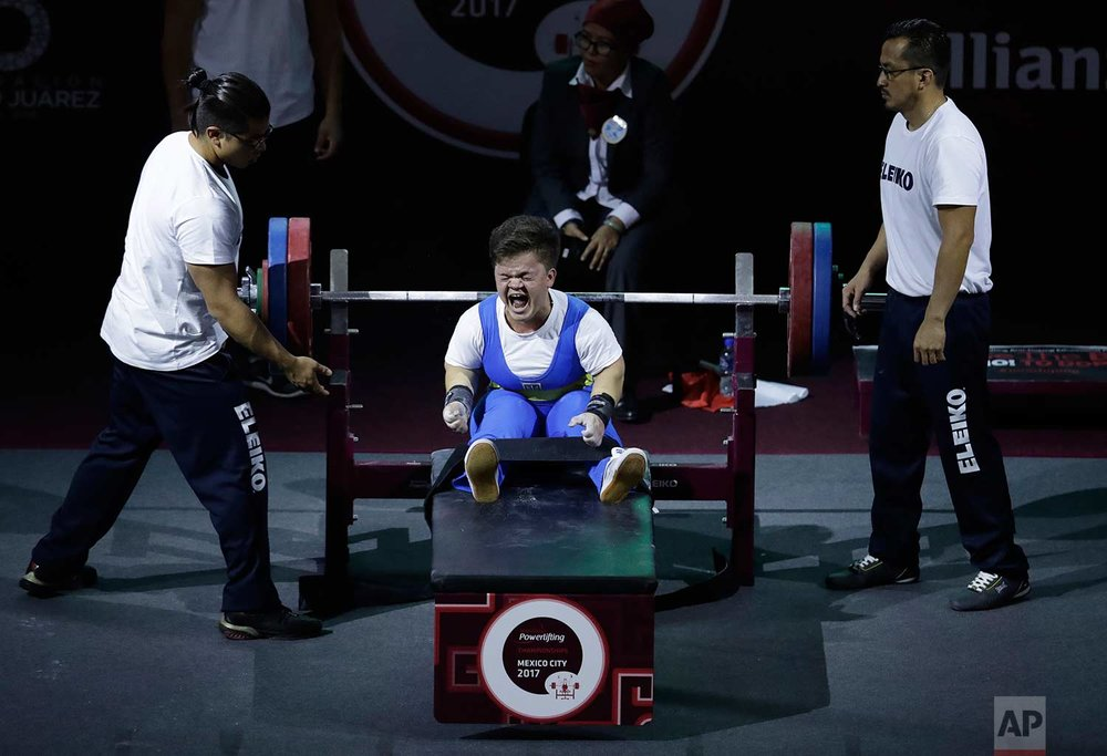 Mariana Shevchuk, of Ukraine, shouts after a successful lift that secured her the silver medal in the women's up to 55kg Group A event, at the World Para Powerlifting Championships in Mexico City, Sunday, Dec. 3, 2017. (AP Photo/Rebecca Blackwell)