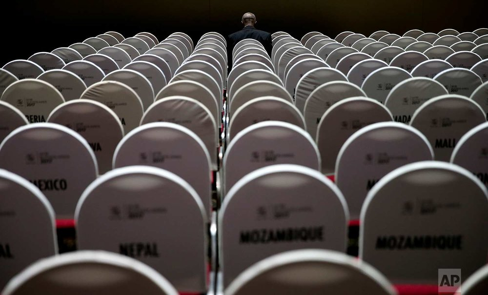 A delegate sits waiting for the start of the Ministerial Conference of the World Trade Organization in Buenos Aires, Argentina, Monday, Dec. 11, 2017. (AP Photo/Natacha Pisarenko)