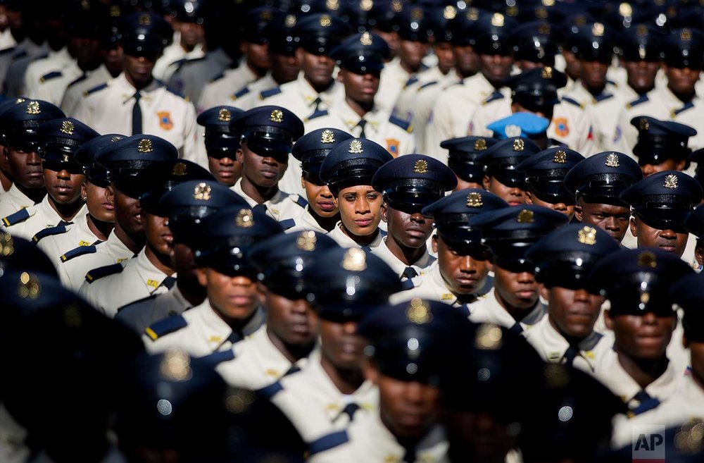 New members of the National Police parade during their graduation ceremony from at the Police Academy in Port-au-Prince, Haiti, Monday, Dec. 18, 2017. (AP Photo/Dieu Nalio Chery)