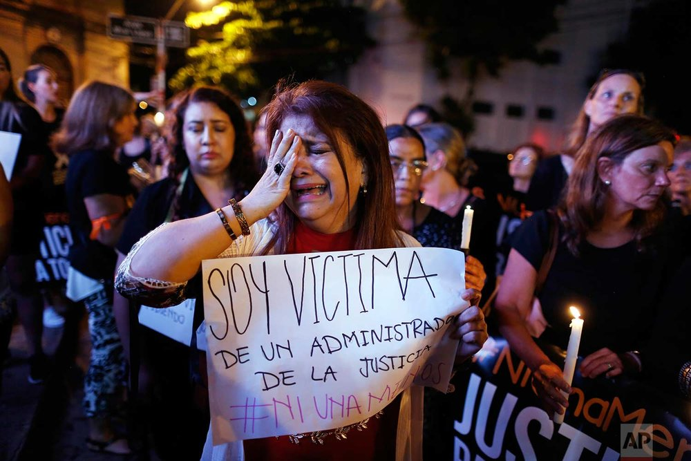 The ex-wife of a judge who said she was attacked by him, cries as she joins a protest against femicides in Asuncion, Paraguay, Thursday, Dec. 21, 2017. (AP Photo/Jorge Saenz)