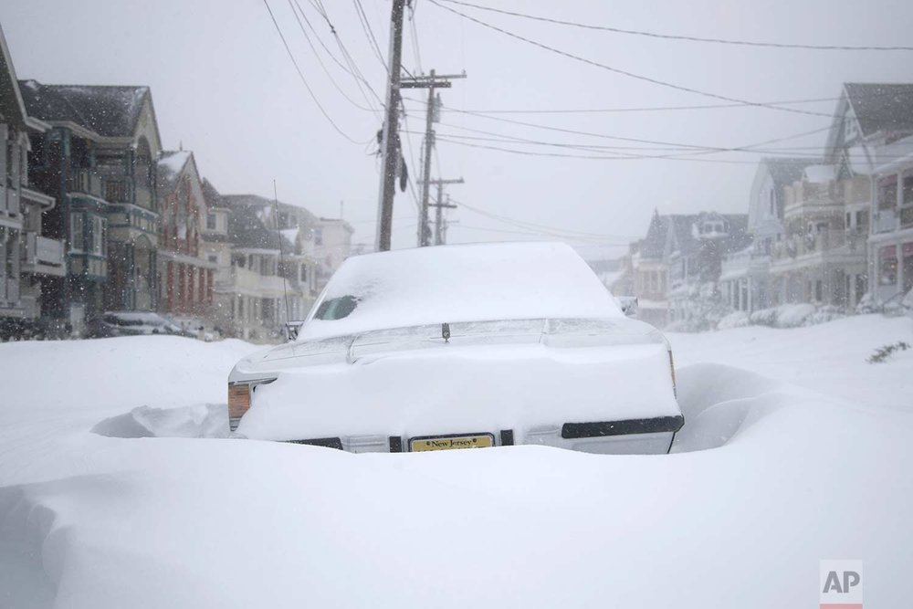 A vehicle parked on Abbott Avenue is engulfed by snowdrifts during a snowstorm that hit the New Jersey Shore, Thursday, Jan. 4, 2018, in Ocean Grove, N.J. (AP Photo/Julio Cortez)