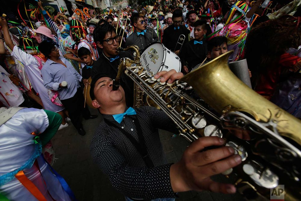 "Musicians perform during the traditional New Year's festival known as ""La Diablada"", in Pillaro, Ecuador, Friday, Jan. 5, 2018. (AP Photo/Dolores Ochoa)"