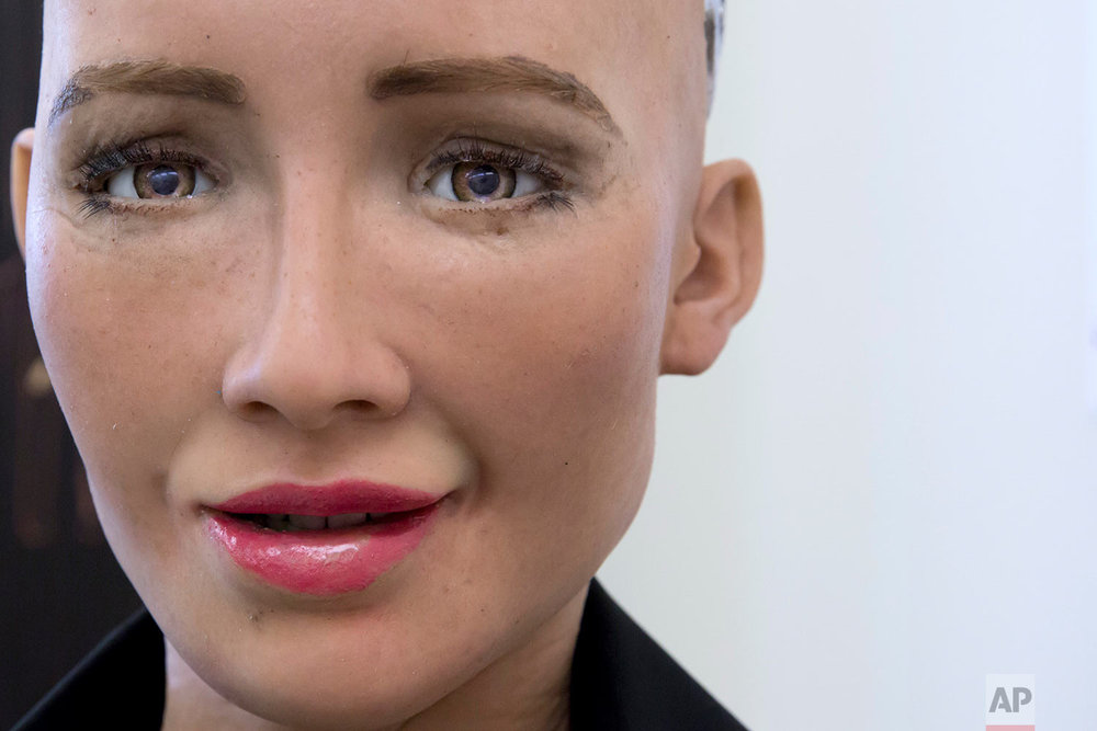 In this Sept. 28, 2017 photo, Hanson Robotics's flagship robot Sophia, a lifelike robot powered by artificial intelligence (AI) speaks in Hong Kong. (AP Photo/Kin Cheung)  |  See these photos on AP Images