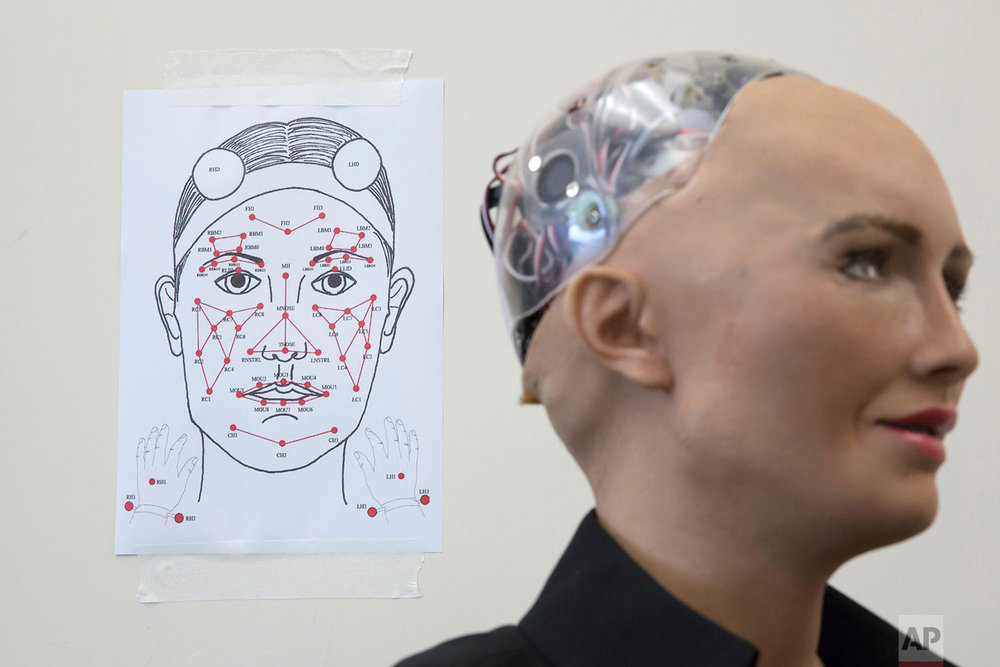 In this Sept. 28, 2017 photo, Hanson Robotics's flagship robot Sophia, a lifelike robot powered by artificial intelligence (AI) is displayed at the office in Hong Kong. Sophia is the creation of Hanson Robotics, a Hong Kong-based startup working on bringing humanoid robots to the marketplace. (AP Photo/Kin Cheung)  |  See these photos on AP Images