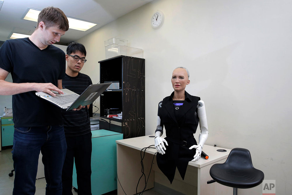In this Sept. 28, 2017 photo, staff members of Hanson Robotics control their company's flagship robot Sophia, a lifelike robot powered by artificial intelligence (AI) in Hong Kong. (AP Photo/Kin Cheung)   |  See these photos on AP Images