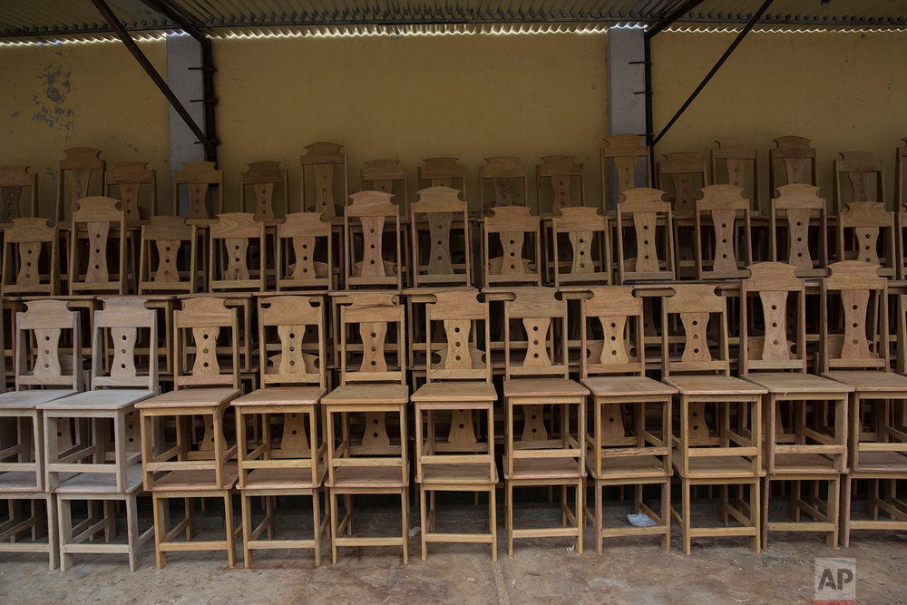 In this Jan. 12, 2018 photo, chairs built by inmates are stored ahead of the visit by Pope Francis, before being delivered to authorities for use by indigenous authorities attending events with the pope in Puerto Maldonado, Madre de Dios province, Peru. They're made of wood from Amazon forests where illegal gold mining and deforestation threaten the delicate ecosystem. (AP Photo/Rodrigo Abd)| See these photos on AP Images
