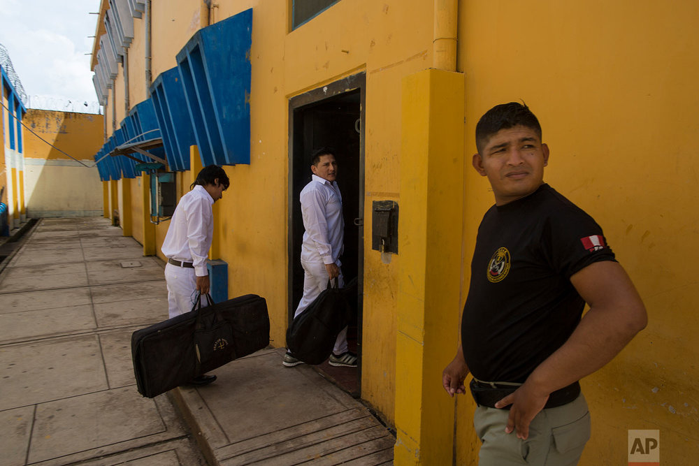 "In this Jan. 12, 2018 photo, inmate band members ""Sin Limites,"" or Without Limits, return to their jail cells after rehearsing their song ""Esperanza y Amor,"" or Hope and Love, written by them especially for Pope Francis' upcoming visit to the Amazon, in Puerto Maldonado, Madre de Dios province, Peru. The pontiff has spoken about the importance of protecting the Amazon in the past, referring to the world's largest rainforest as one of the ""lungs of our planet"" in a letter to bishops. (AP Photo/Rodrigo Abd) 