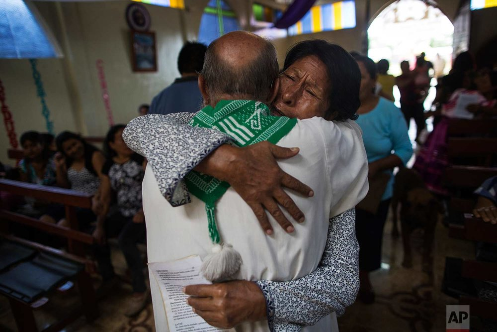 In this Jan. 14, 2018 photo, parishioner Lucero Fatima Cusi embraces Father Pablo Zabala, better known as Padre Pablo, during his last day as parish priest in Boca Colorado, part of Peru's Madre de Dios region. (AP Photo/Rodrigo Abd) |  See these photos on AP Images